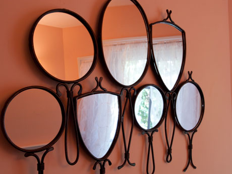 Playful mirror decor in the private bathroom of the West High room at downtown Charlottesville Virginia bed and breakfast The Inn at 400 West High
