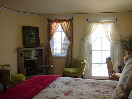 Altamont Room with king bed and gas fireplace at the Inn at 400 West High in historic Charlottesville, Virginia