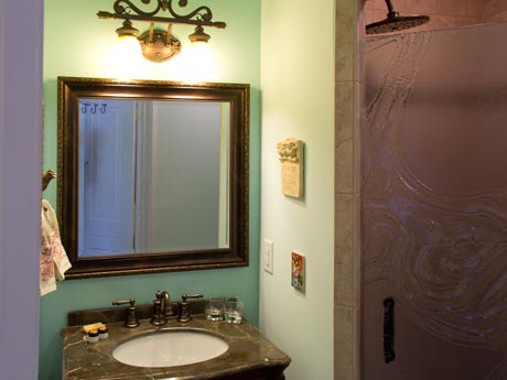 Private bathroom in the Preston Suite at the Inn at 400 West High in Charlottesville, Virginia, with rainhead shower and plenty of light