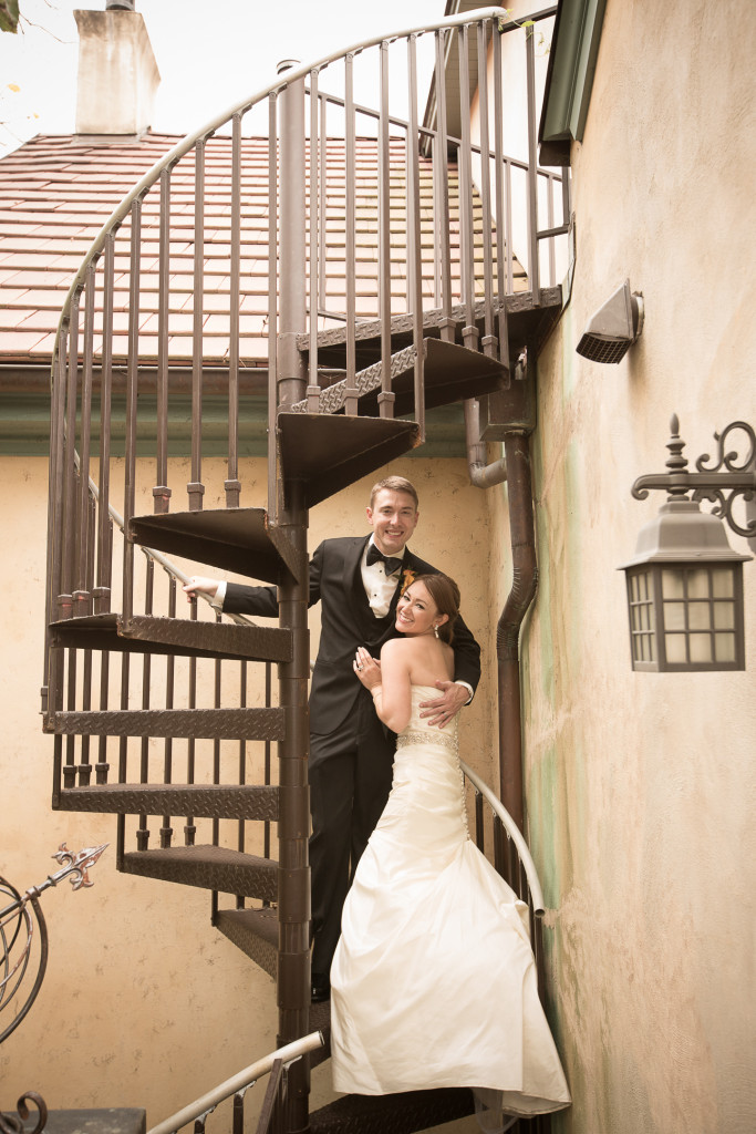 Wedding photography - bride and groom on spiral staircase at historic downtown Charlottesville bed and breakfast