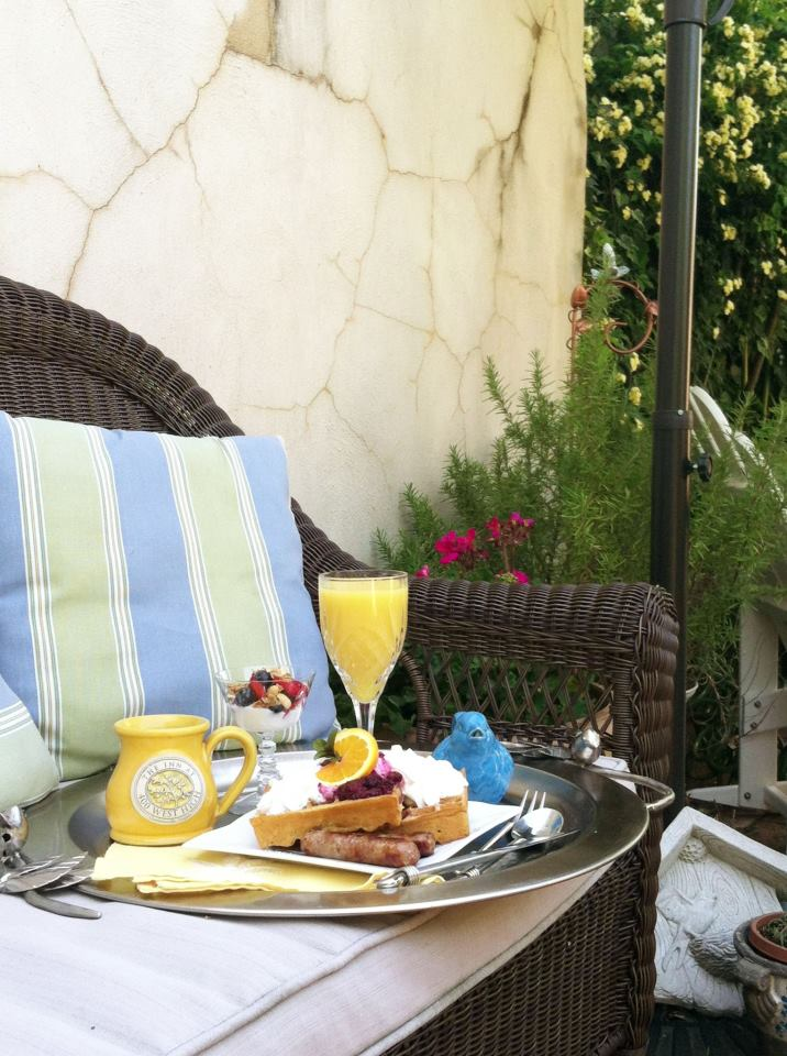 Fresh coffee, orange juice, fresh fruit parfait, and belgian waffles at The Inn at 400 West High, a downtown Charlottesville Virginia bed and breakfast