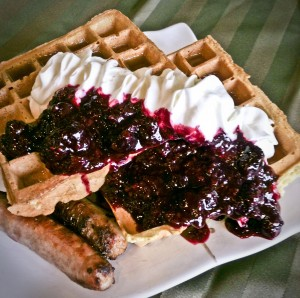 waffles with mixed berries and whipped cream