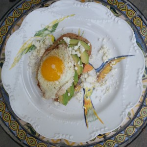 breakfast at the inn: avocado toast with feta and a fried egg